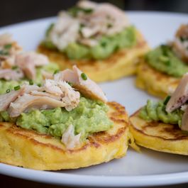 Corn-cakes-avocado-trout-round-white-plate