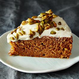 Pumpkin Cake with Cream Cheese Icing and Caramelized Pumpkin Seeds