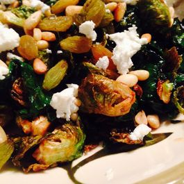 Crispy Brussels sprouts with kale + an addictive pomegrante molasses vinaigrette