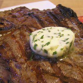 Melting-herbed-butter-on-steak