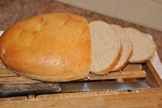 Dinner_table_bread_sliced_on_board