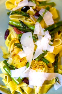 Lemon papperdelle with asparagus, and artichoke in a brown butter