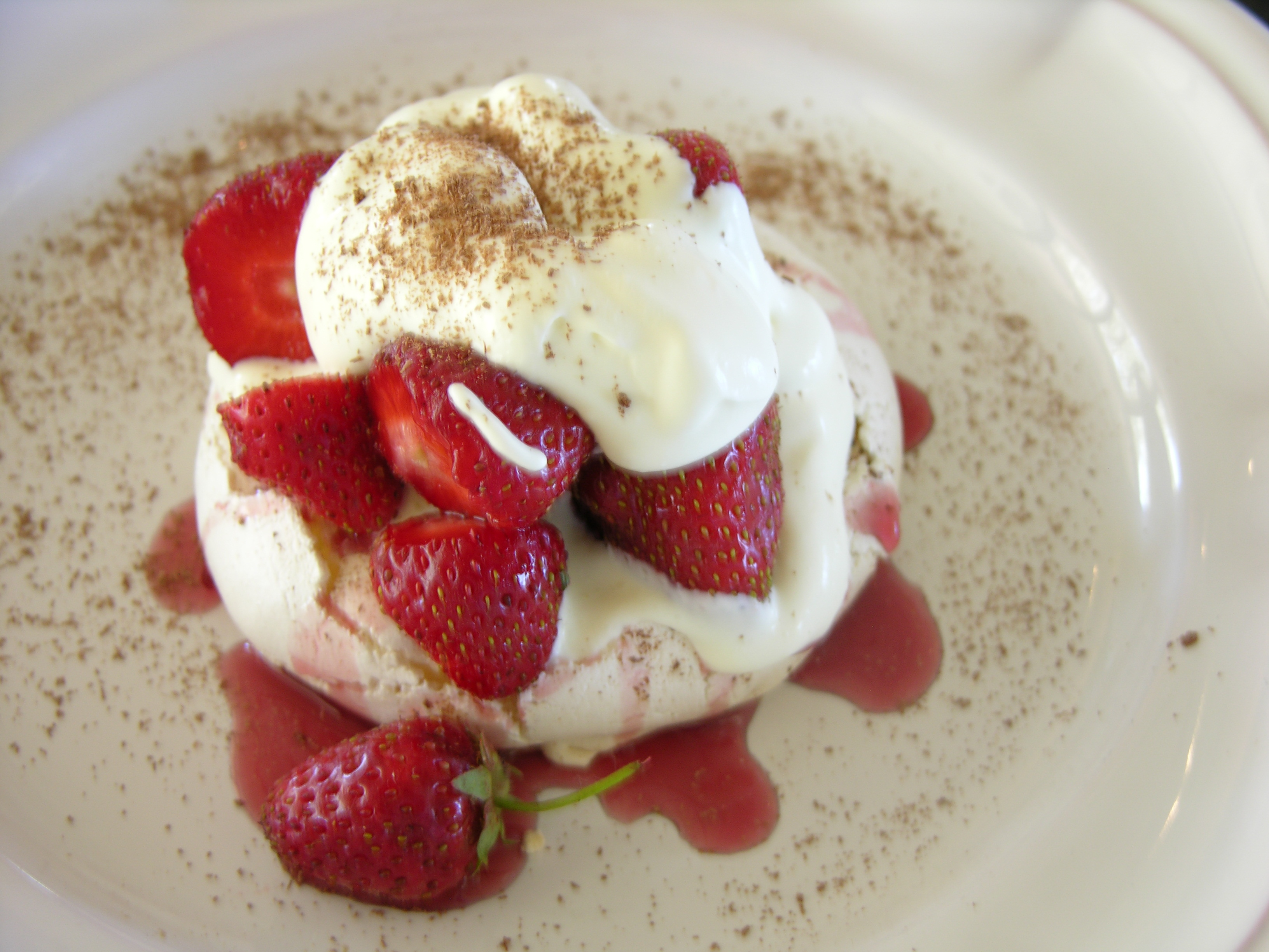 CHOCOLATE DUSTED MERINGUES W/FRESH STRAWBERRIES AND AMANDA'S PRESERVED STRAWBERRIES W/CHILIES