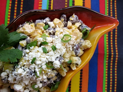 Roasted corn (esquites) with black beans, lime dressing and queso Cotija