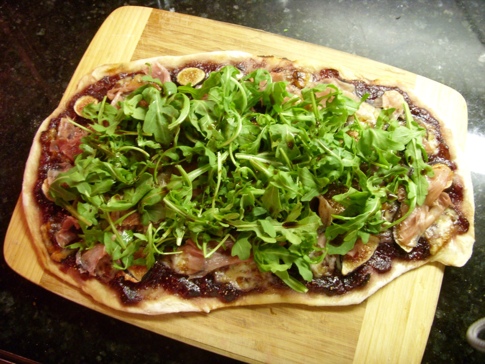 Fresh Fig Jam Flatbread with Roasted Figs, Prosciutto, Manchego and Arugula