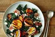A Kale Salad with Grilled Stone Fruit, Prosciutto, and Feta