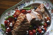 Grilled Pork Tenderloin with Goat Cheese, Tomato, and Blueberry Salad