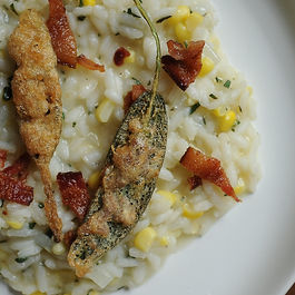 Corn Risotto with Anchovy Sage Leaf Bite