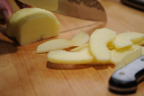 Merrill slices Honey Crisp apples.